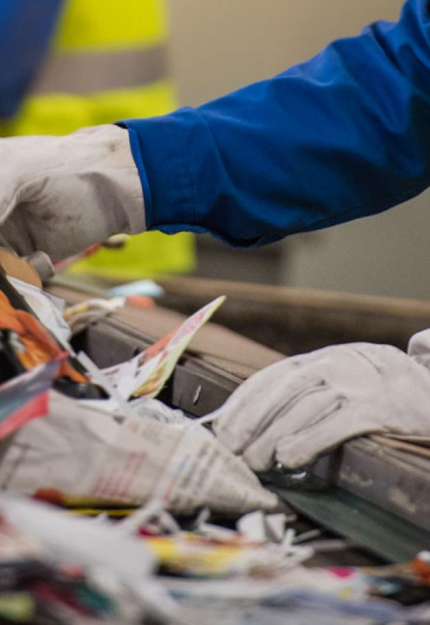Operatives sorting recycling on a conveyor belt