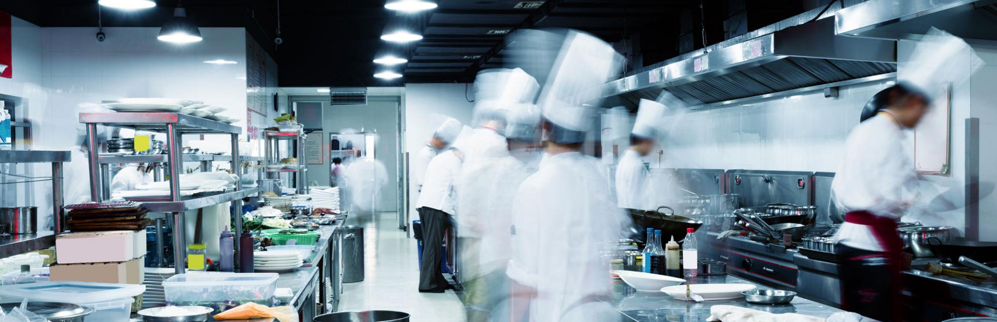 Blurred view of chefs working in a kitchen