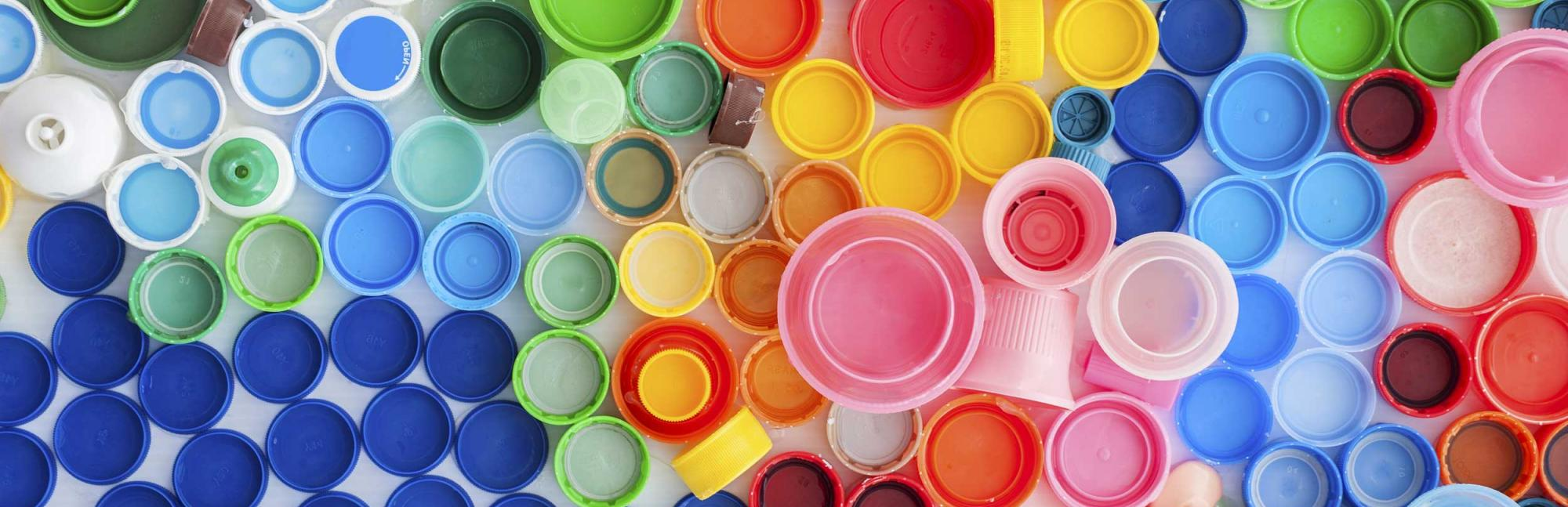 Lots of brightly coloured plastic bottle lids