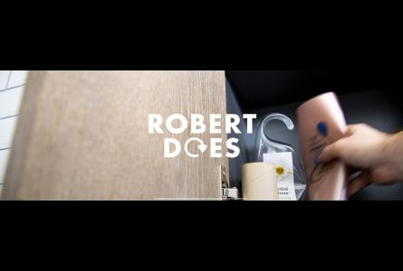 'Robert does' text over image of hand grabbing empty plastic bottles from bathroom cabinet